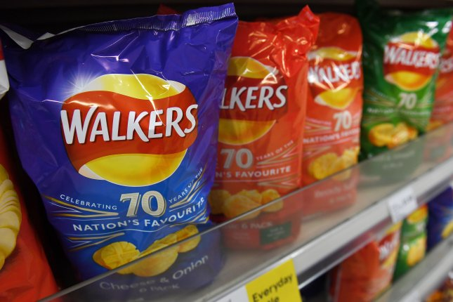 Britain's Royal Mail is asking residents to stop mailing empty packets of Walkers potato chips without an envelope to protest the company's non-recyclable packaging. Photo by Andy Rain/EPA-EFE
