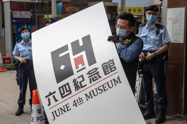 Police load pieces of evidence from the June 4th Museum into a truck in Hong Kong on Thursday during a raid. Photo by Jerome Favre/EPA-EFE