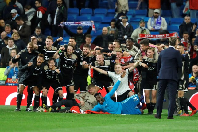 Ajax players celebrate their win after the UEFA Champions League round of 16 second leg match between Real Madrid and Ajax Amsterdam on Tuesday at Santiago Bernabeu Stadium in Madrid, Spain. Photo by Juanjo Martin/EPA-EFE