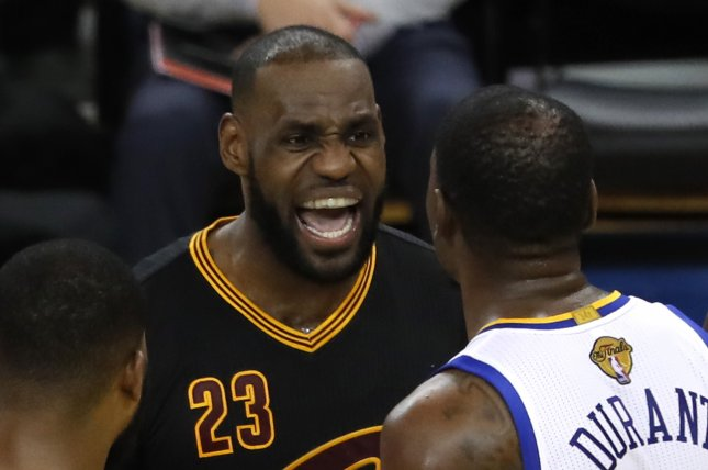 a949785e229a Golden State Warriors forward Kevin Durant (R) and Cleveland Cavaliers  forward LeBron James (L) exchange words on court in the second half of Game  5 of the ...