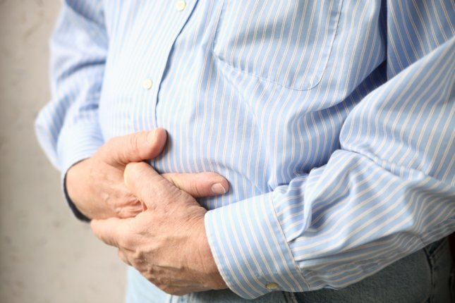 People with Crohn's disease were found in a recent study to have elevated levels of a yeast found in cheese and processed meats, which researchers say could lead to better treatments of the condition. File Photo by Alice Day/Shutterstock