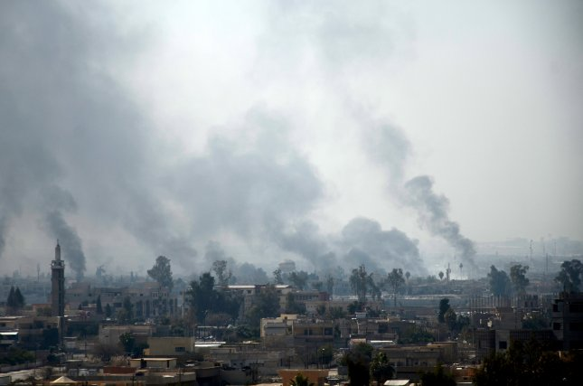 Senior U.S. military leaders announced an investigation into reports that up to 200 civilians were killed in recent U.S. coalition air strikes in Mosul. Pictured: A general view of smoke clouds rising from the western part of Mosul in Iraq on February 24. Iraqi military forces on February 18 started an offensive to regain control over the Western part of Mosul from the Islamic State. The eastern half of the city was liberated from IS militants at the end of January. Photo by STR/ EPA
