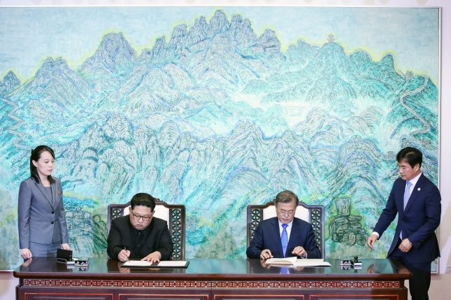 South Korean President Moon Jae-in and North Korea leader Kim Jong Un sign the Panmunjom Agreement on Friday. Photo courtesy of Inter-Korean Summit Press Corps/UPI