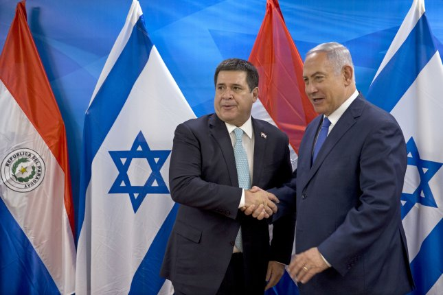 Israeli Prime Minister Benjamin Netanyahu greets Paraguayan President Horacio Cartes in Jerusalem, Israel, on May 21 after Cartes ordered his embassy to move to Jerusalem from Tel Aviv. Wednesday, it was announced new Paraguayan President Mario Abdo Benitez will move the consulate back. File Photo by Sebastian Scheiner/EPA-EFE