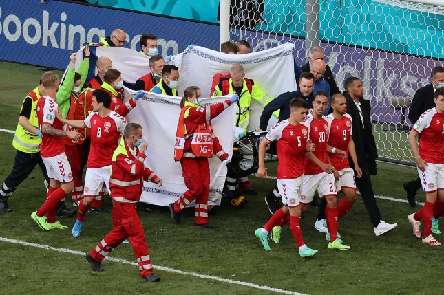 Denmark soccer star Christian Eriksen (behind sheets) collapsed on the field from a cardiac arrest during a game against Finland on Saturday in Copenhagen, Denmark. Photo by Wolfgang Rattay/EPA-EFE