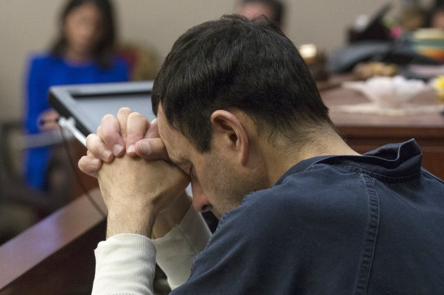 Larry Nassar listens to victim impact statements during his sentencing in Lansing, Mich., in January. Photo by Rena Laverty/EPA