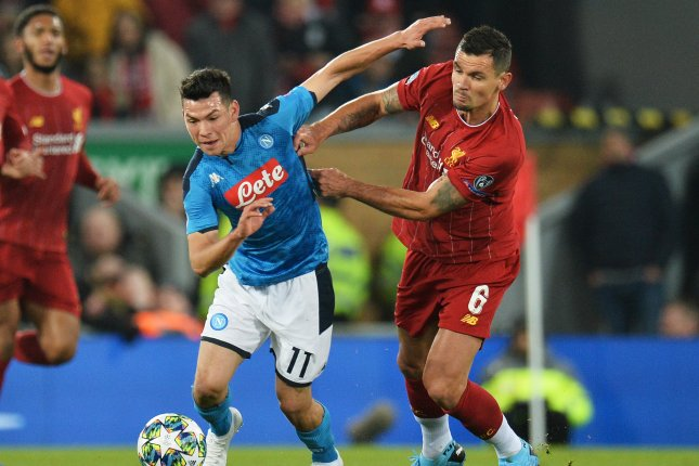 Liverpool's Dejan Lovren (R) scored a second-half equalizer to help the Reds earn a point in the Champions League standings after a game against Napoli Wednesday in Liverpool, England. Photo by Peter Powell/EPA-EFE