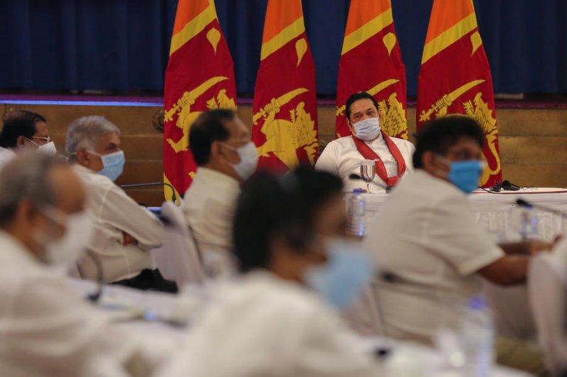 Prime Minister Mahinda Rajapaksa (2nd-R) wears a face mask during a meeting Thursday in Colombo, Sri Lanka. Photo by Chamila Karunarathne/EPA-EFE