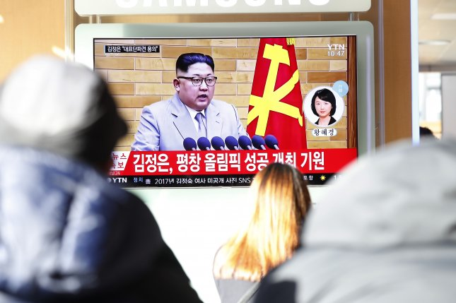 Kim Jong Un extends olive branch to Seoul while threatening Washington with 'nuclear button'
