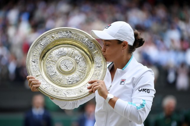 Ash Barty of Australia kisses the trophy after winning her women's final match against Karolina Pliskova of the Czech Republic at the Wimbledon Championships on Saturday in London. Photo by Neil Hall/EPA-EFE