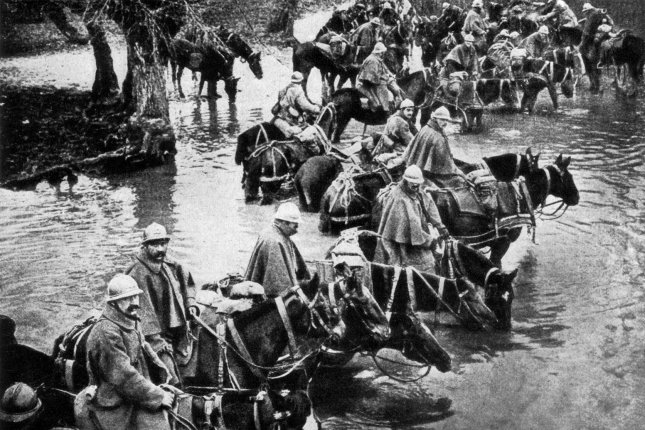 French reserves cross a river on the way to the Battle of Verdun in 1917. File Photo courtesy Wikimedia