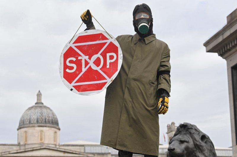 An Extinction Rebellion activist blocks a road in London's Trafalgar Square on October 7. Photo by Facundo Arrizabalaga/EPA-EFE