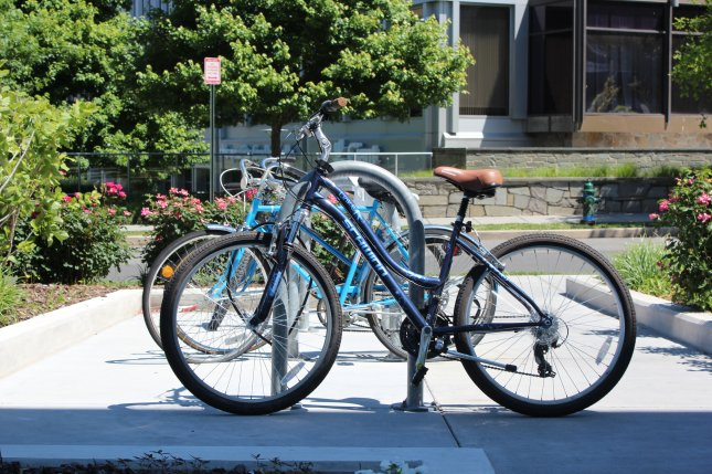 Research in England suggests that biking or walking to work, instead of driving, could help improve heart health. File Photo by Billie Jean Shaw/UPI