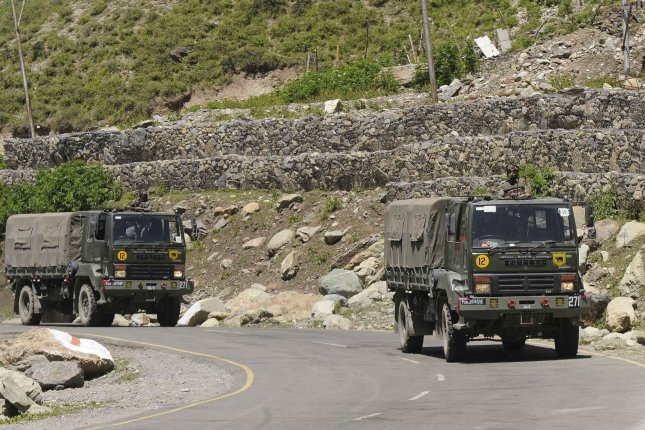 Indian military vehicles are seen on a highway in Jammu and Kashmir, India, on June 22. India and China traded accusations Tuesday of gunfire at the border region shared by the two nations. File Photo by EPA-EFE
