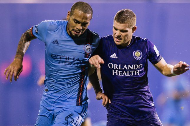 Orlando City SC midfielder Chris Mueller (R) scored two first-half goals in a 3-1 win against New York City FC Tuesday in Orlando, Fla. Photo courtesy of Orlando City SC