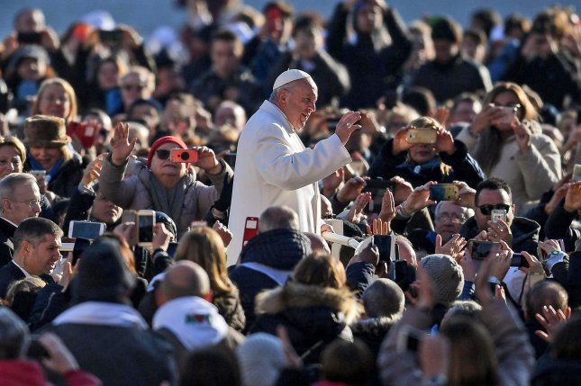 Pope Francis waves to faithful in Saint Peters Square on January 24. Wednesday, the Vatican announced the pontiff had signed decrees to canonize Pope Paul IV and slain Salvadoran Archbishop Oscar Romero later this year. File Photo by Alessandro di Meo/EPA-EFE