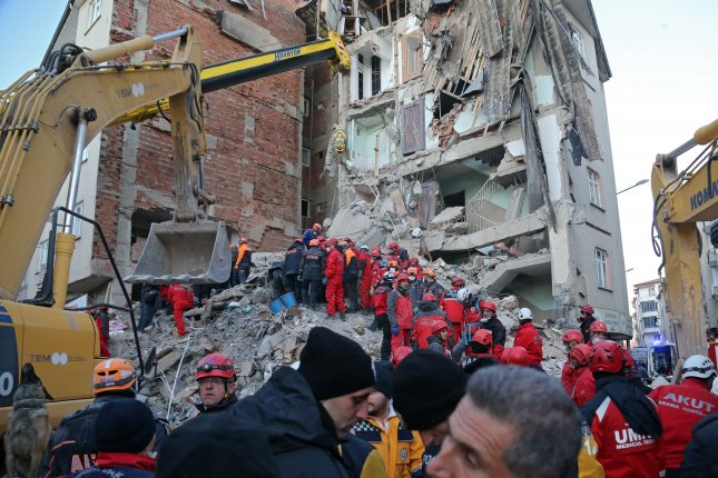 Rescue workers search for survivors Saturday in the rubble of a building after a 6.7-magnitude earthquake hit Elazig, Turkey, on Friday. Photo by Stringer/EPA-EFE