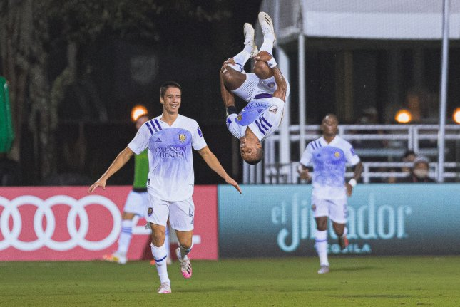 Orlando City SC winger Nani (flipping) scored twice in the MLS Is Back Tournament semifinals Thursday, in Orlando, Fla. Photo courtesy of Jared Martinez/Matthew Stith/Devin L'Amoreaux/MLS