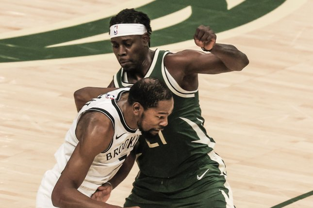 Milwaukee Bucks guard Jrue Holiday (R), shown May 2, 2021, received 130 of 343 first-place votes in balloting of NBA players. File Photo by Tannen Maury/EPA-EFE