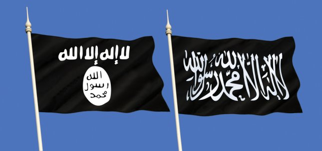 Flags flown by the Islamic State. A United Nation report stated a core of between 20,000 and 30,000 IS members remains intact and equally distributed between Iraq and Syria. Photo by Steve Allen/Shutterstock