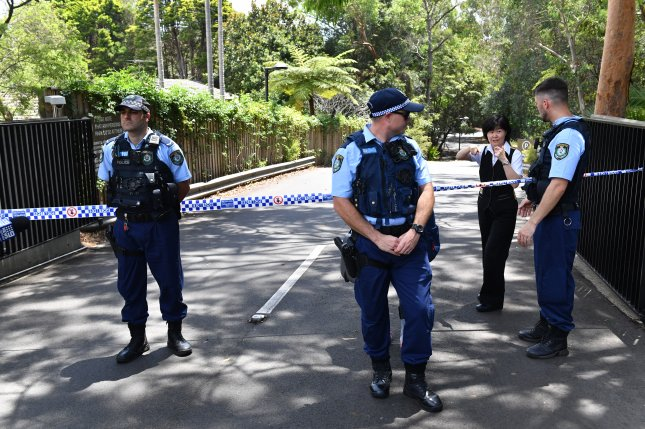 New South Wales police stand guard at the scene of a double stabbing at the Church of Scientology headquarters in Chatswood, Sydney Thursday. Photo by Mick Tsikas/EPA-EFE