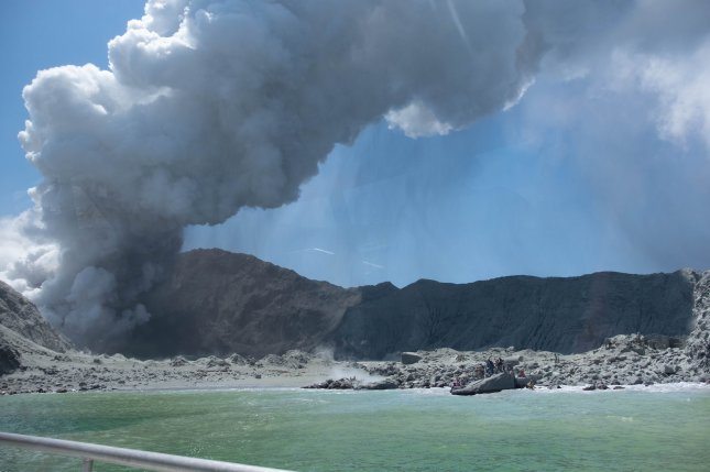 White Island, or Whakaari, in the Bay of Plenty, New Zealand, is seen December 9 after erupting. The island is located around 25 miles offshore of the Bay of Plenty. Photo by Michael Schade/EPA-EFE