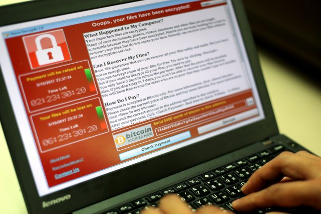 A programmer shows a sample of ransomware -- which locks up user data until money is paid -- on a laptop computer. Authorities said Tuesday a ransomware attack was launched against about 2,000 government and private servers in Russia, Ukraine, Britain and elsewhere. File Photo by Ritchie B. Tongo/EPA