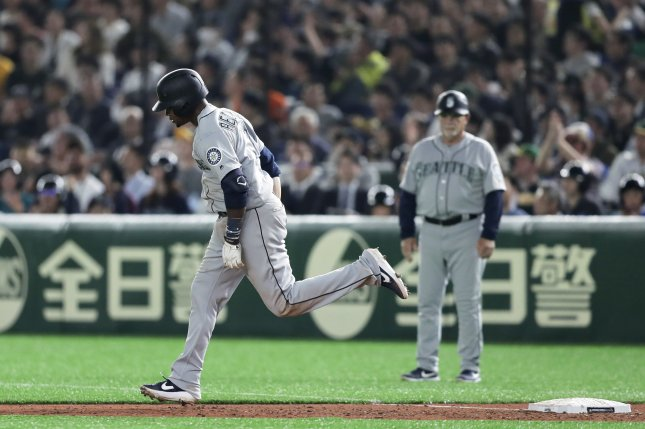 Seattle Mariners shortstop Tim Beckham threw his bat in the air after smacking a two-run homer during a win against the Oakland Athletics on Wednesday at the Tokyo Dome in Japan. Photo by Kiyoshi Ota/EPA-EFE