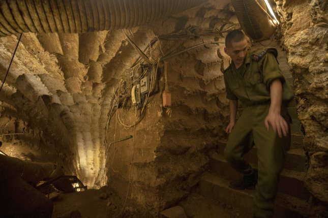 An Israeli soldier appears in a tunnel dug by the Lebanese militant group of Hezbollah near the Israeli town of Zar'it at the Israeli border with Lebanon last July 4. Israel's military discovered and destroyed six tunnels dug by the Hezbollah terror group as part of Operation Northern Shield. Photo by Atef Safadi/EPA-EFE