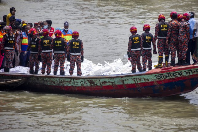 Authorities in Bangladesh said at least 32 people died, including eight women and three children, after a passenger boat collided with a large ferry and capsized on Monday. Photo by Monirul Alam/EPA-EFE