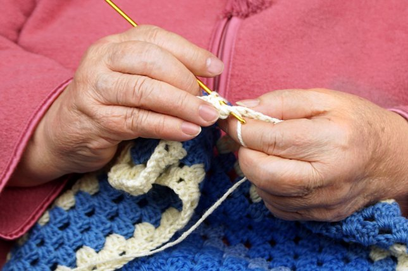 A woman crocheting. Photo by Tania Anisimova/Shutterstock.com
