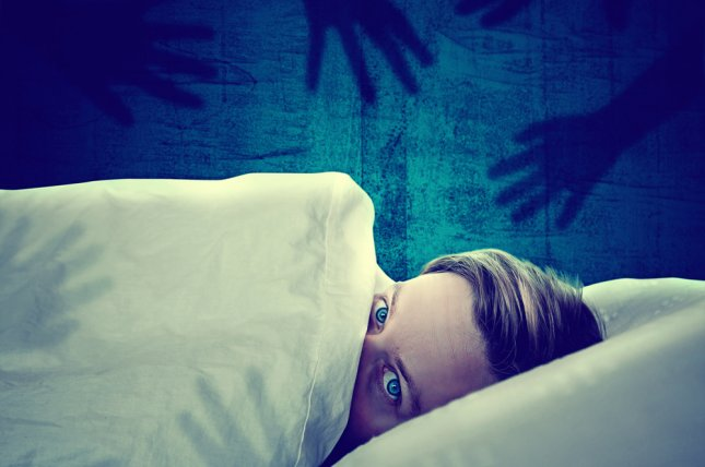 Sleeping fewer than six hours raises heart attack risk by 20 percent, but getting more than nine hours raises the risk by 34 percent. File Photo by lassedesignen/Shutterstock