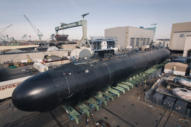 The 7,800-ton Virginia-class submarine Delaware was moved out of a construction facility into a floating dry dock using a transfer car system, Huntington Ingalls Industries said on Monday. Photo by Ashley Cowan/HII