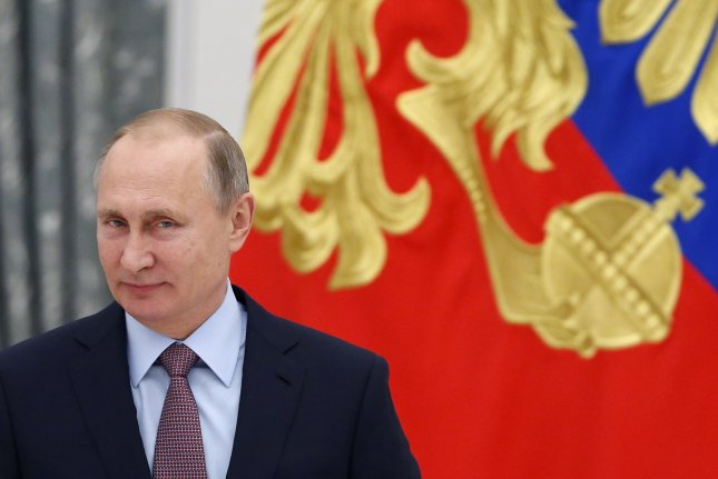 Russian President Vladimir Putin says his country will honor its oil production commitments, but stresses Russia is not a member of OPEC. EPA/SERGEI ILNITSKY/POOL