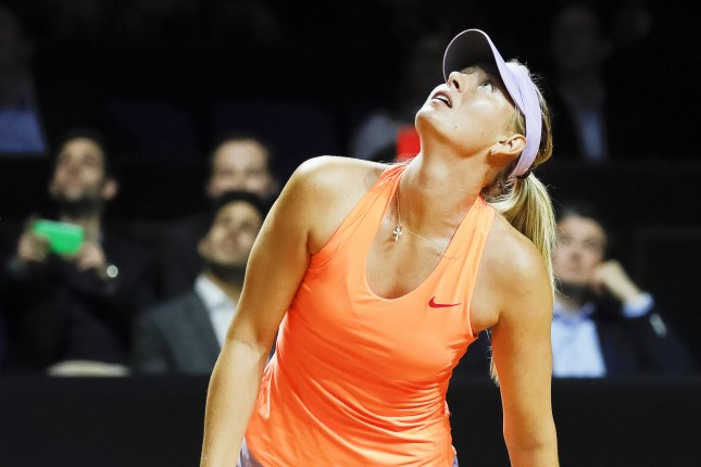 Maria Sharapova of Russia reacts during her second round match against her compatriot Ekaterina Makarova at the Porsche Tennis Grand Prix tournament on Thursday in Stuttgart, Germany. File photo by Ronald Wittek/EPA