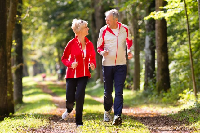 Post-menopausal woman walking at an average pace for at least 40 minutes several times per week can reduce their risk of heart disease by nearly 25 percent, according to a new study. Photo by Kzenon/Shutterstock
