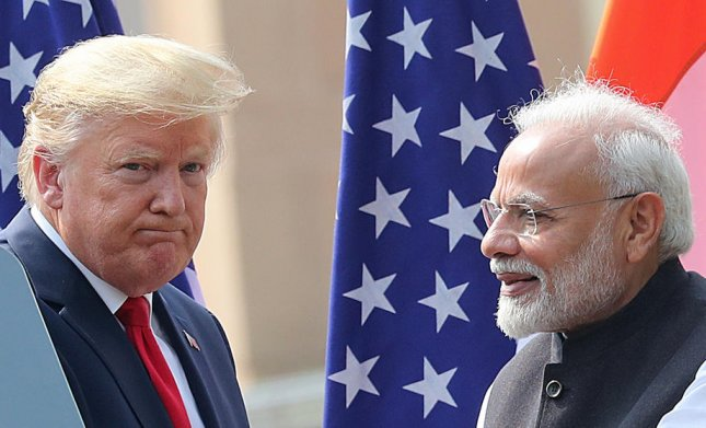 Indian Prime Minister Narendra Modi (R) stands with U.S. President Donald J. Trump after addressing the media in New Delhi, India, on Feb. 25. Photo by Harish Tyagi/EPA-EFE
