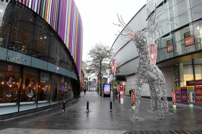 A shopping area in downtown Liverpool, England, is deserted Tuesday on the first day of a new lockdown imposed to stop the spread of COVID-19. Photo by Peter Powell/EPA-EFE
