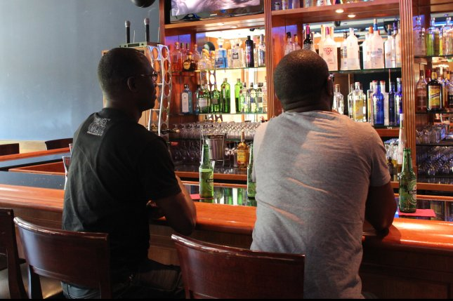 Two men sit at a bar and drink in Washington, DC. (File/UPI/ Billie Jean Shaw)