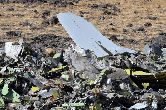 Pieces of the wreckage from an Ethiopia Airlines Boeing 737 Max 8 are seen at the crash site near Bishoftu, Ethiopia, on March 13. File Photo by EPA-EFE