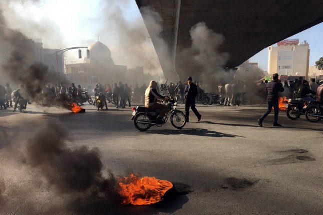 Iranian protesters block a highway following fuel price increase in Isfahan, Iran, on Saturday. Photo by EPA-EFE