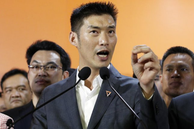 Thanathorn Juangroongruangkit (C), former leader of the Future Forward Party in Thailand, was charged under the country's lese-majeste law Wednesday, according to reports. File Photo by Rungroj Yongri/EPA-EFE