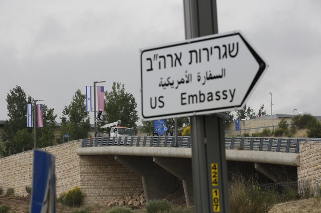 A new road sign is placed at the road leading to the U.S. consulate in the Jewish neighborhood of Arnona on the East-West Jerusalem line in Jerusalem, Israel, on Monday. Photo by Abir Sultan/EPA-EFE