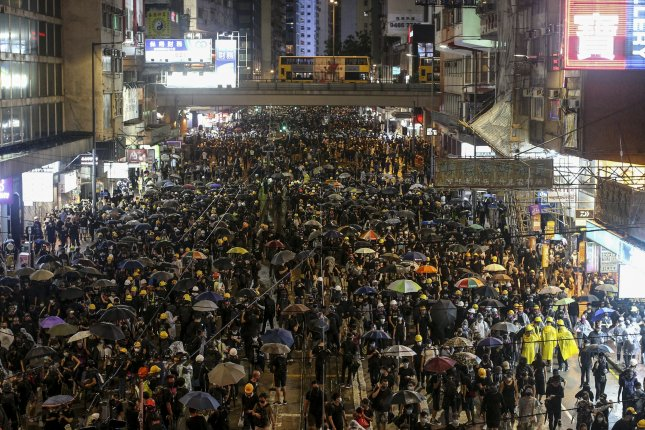 Protesters march along a road during an anti-government rally in Hong Kong, China, on Saturday. Hong Kong has been gripped by mass protests since June over a now-suspended extradition bill to China that have morphed into a wider anti-government movement. Photo by Jerome Favre/EPA-EFE