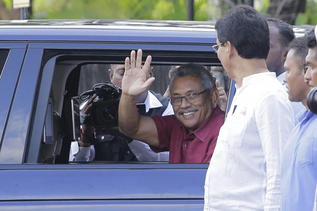Gotabaya Rajapaksa waves to supporters in Colombo, Sri Lanka on Sunday after the announcement of his victory in the country's presidential election. Photo by EPA-EFE/STR