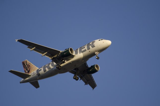 Low-cost carrier Frontier Airlines is offering free flights for people with the surnames Green and Greene during its Green Week initiative. File Photo by Paul Matthew Photography/Shutterstock.com