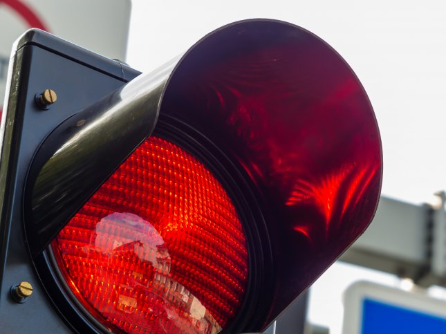 A 6-year-old boy showed his commitment to law enforcement by reporting his father to 911 for running a red light. The boy told the dispatcher his father drove past a red light while driving his mother's car to the car wash. Photo by Lisa S./Shutterstock.com