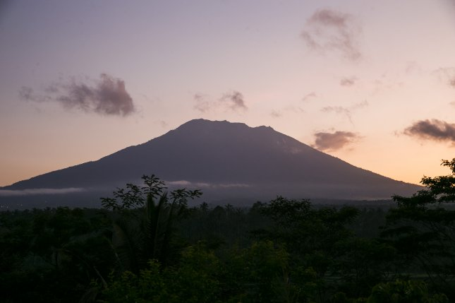 \Mount Agung is seen during sunrise from nearby village in Karangasem, Bali, Indonesia. New research suggests tropical eruptions can trigger El Niño events in the Pacific. Photo by EPA-EFE/MADE NAGI