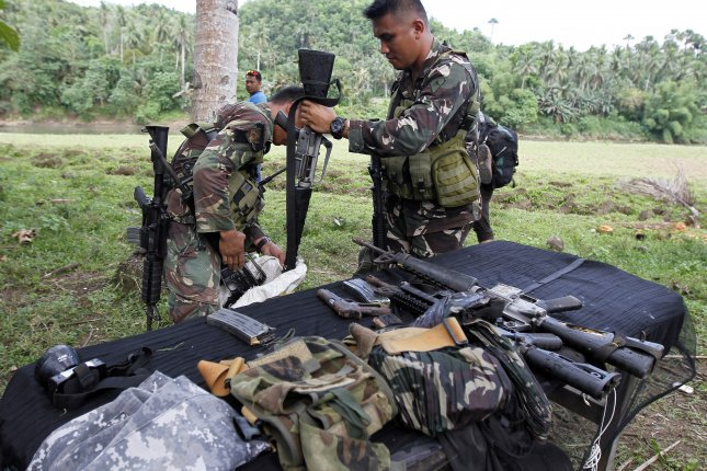 Philippine troops killed Abu Sayyaf leader Joselito Melloria during a clash on the resort island of Bohol on Saturday, officials said. Pictured: Filipino soldiers collect confiscated firearms from alleged slain Abu Sayyaf members in the town of Ibanga, Bohol island, Philippines on April 12, 2017. Photo by Jay Rommel Labra/EPA