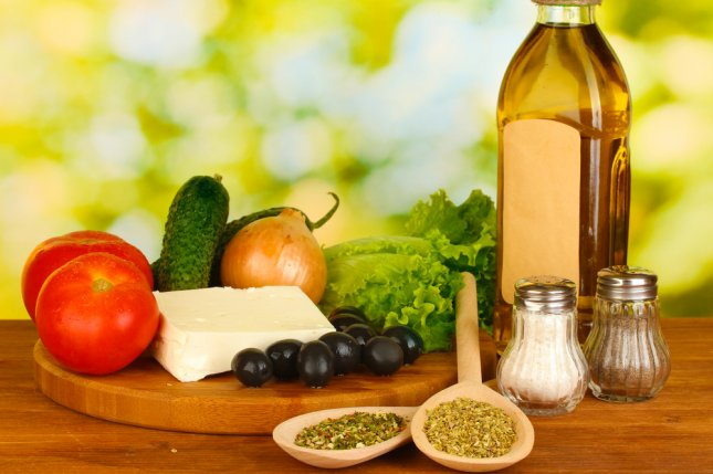 The alternate Mediterranean diet score measures adherence to the Mediterranean diet, which calls for high consumption of olive oil, legumes, unrefined cereals, fruits, and vegetables. New research suggests the diet can help lower risk of hearing loss in women. Photo by Africa Studio/Shutterstock